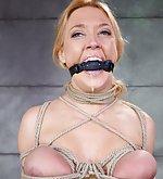 Busty blonde slut in tight rope bondage