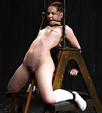 Redhead fixed, cuffed, chained and dildoed