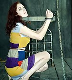 Redhead handcuffed, chained, dildoed