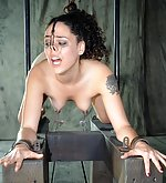 Sexy brunette suffers in cuffs and chains