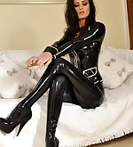 Brunette poses in shiny black latex suit