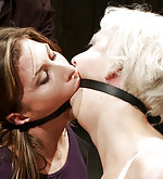 Two pain sluts are double gagged and belted