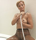 Silvia in wet pantyhose poses in bathroom