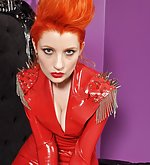 Redhead in red latex catsuit and heels