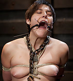 She is tied to a sybian, chained, pegged