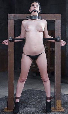 Shackled to a wooden frame, spanked, humiliated