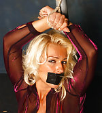 Hot blonde milf is bound and tape-gagged