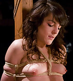 Pretty brunette in her first bondage