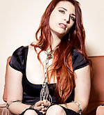 Redhead beauty cuffed and chained