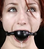 Redhead pet roped, gagged and fucked