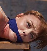 Redhead slut bound tight in suspended hogtie