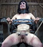 Put in metal bondage, clasped and caned