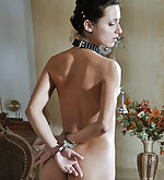 Fit brunette gets cuffed, clasped, whipped, dildoed