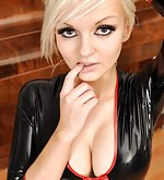 Blondie in black latex pants and black latex top