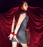Redhead poses with roped hands
