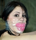 Two brunettes locked, gagged, spanked