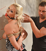 Karol on a string bound and ball-gagged