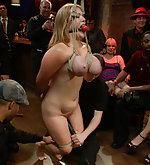 Two busty girls are tied up and fucked
