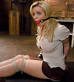 Busty blonde is fucked in strict bondage