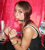Kinky girl plays with cuffs, gags and gasmask
