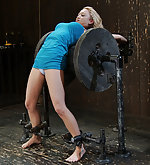 Cute blonde metal bound over a spool