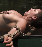 Naked, roped and suspended outdoors