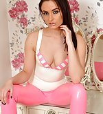 Sarah poses in white and pink latex