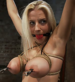 Cute busty blonde in her first bondage shoot