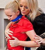 Two blondes tie each other with silk scarves