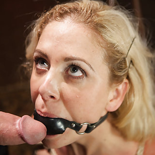 Beautiful blond face fucked while in bondage