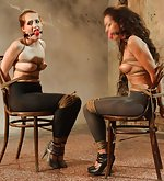 Two girls chair-tied, struggling, whining
