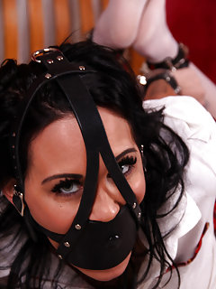 Hogtied with cuffs and gagged with leather