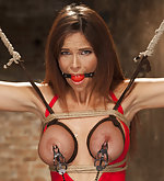 Busty woman tied tight in predicament bondage