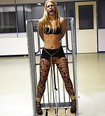 Blond doll caged with dildo in her pussy