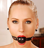 Naked, cuffed, ball-gagged, blindfolded
