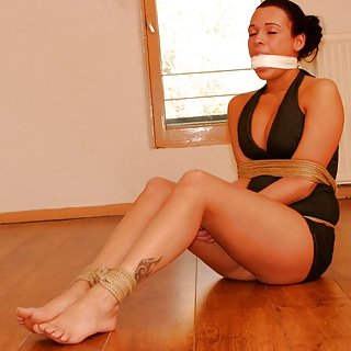 Roped, mouth-stuffed, cleave-gagged