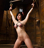 Brunette gets intense crotch rope predicament