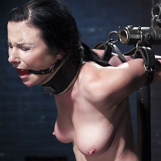 Fixed in metal bondage, whipped, forced to cum
