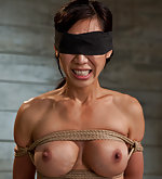 Asian beauty roped, pegged and fucked