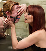 Cute redhead dominated by lesbian dominatrix
