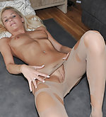 Missy poses in cut open pantyhose