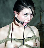 Sexy brunette roped and mouth fucked