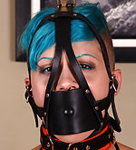 Cuffed to the table, panel-gagged, vibrated
