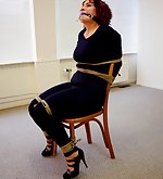 Redhead milf is chair-tied and ball-gagged