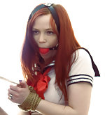 Redhead schoolgirl roped and ball-gagged