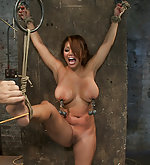 Bound standing spread, flogged & clamped