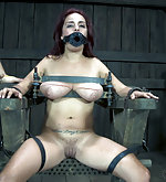 Redhead cuffed, locked, caned, milked