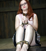 Redhead gets cuffed, caged, suspended