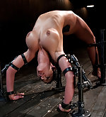 Metal bondage, heavy torment, anal fisting