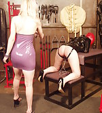 Latex blonde plays with tied girl